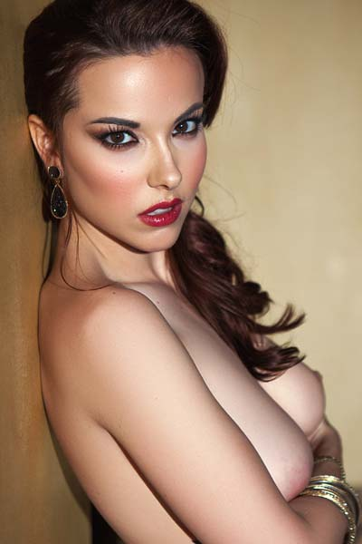 Wonderful busty brunette babe Elizabeth Marxs holds nothing back as she poses eroticaly