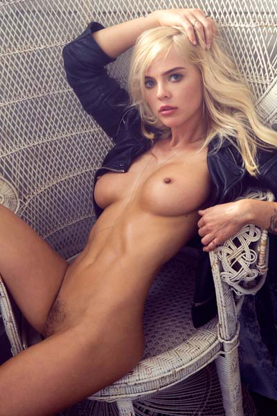 Magnificent blonde with stunning breasts Rachel Harris strips and poses on the bed
