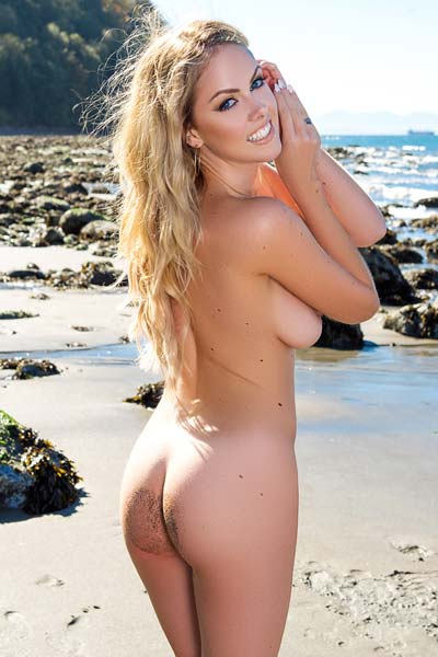 All natural blonde Heidi Michel reveals her curves by the sea