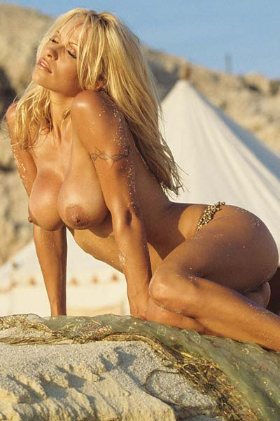 Blonde Bombshell Pamela Anderson nude at the beach