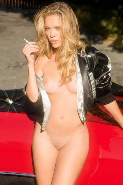 Perky blonde Kristy Garett strips and poses in the front seat