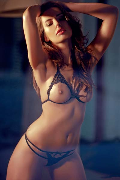 Curvy and seductive Marta Korcz showcases her perfect body erotically