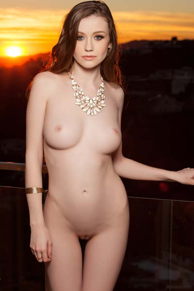Classy brunette Emily Bloom slowly strips and poses on the stairs