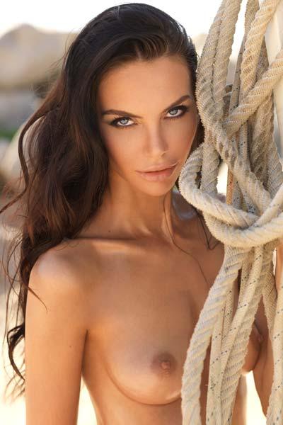 Russian model Olga Rom flaunts her perky breasts