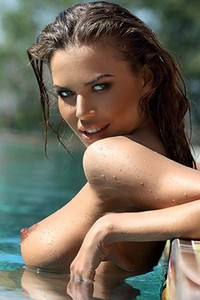 Stunning Svitlana Chumachenko playfully poses by the pool