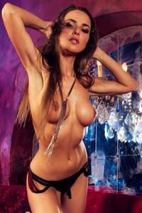 Busty Lien Biesheuvel undressing erotically under dimmed lights