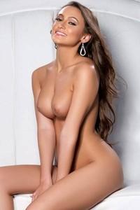 Long legged brunette Deanna Greene squeezes her big round boobs