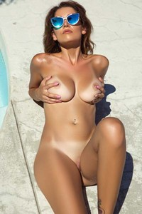 Stunning tanned brunette Ali Rose shows off her big boobs