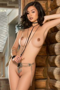 Seductive cowgirl Eden Arya bares her stunning curves