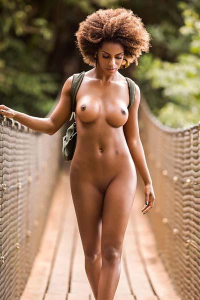 Brazilian goddess Ivi Pizzot poses in the wild