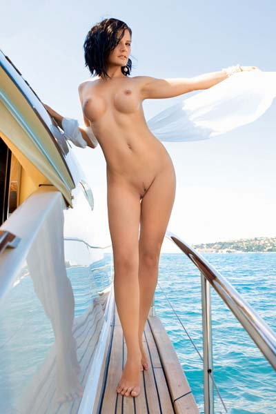 Busty bombshell Ana Dravinec displays her amazing curves on a yacht