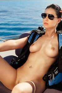 Busty black haired goddess Sabina Jucikaite flaunts her inviting natural breasts
