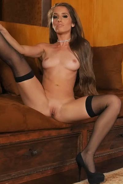 Sexy bombshell Melissa Lori knows how to tease in her tight black stockings