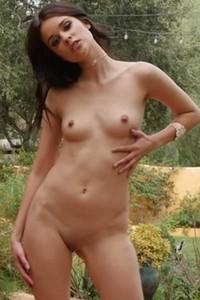 Gorgeous brunette in high heels Salena Storm displays her marvelous natural curves