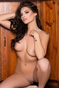 Shelly Lee bares her hot and sexy tattooed body as she enjoys her breakfast