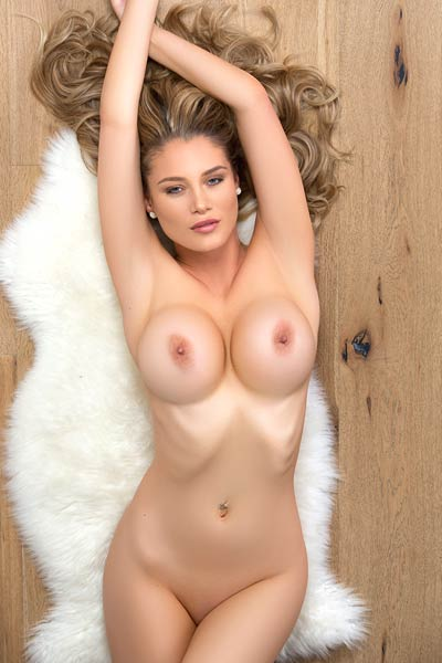 Perfect blonde drops her sexy lingerie and unveils her large tits and yummy muff