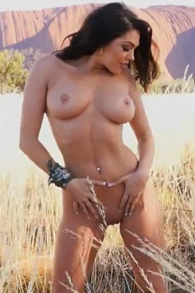 Well stacked babe seductively poses in the desert and flaunts her hot massive tits