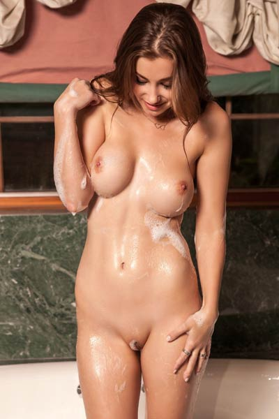 Irresistible babe showcases her yummy smooth pussy while taking a bath in a jacuzzi