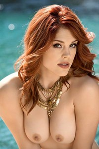 As this sexy redhead went into the pool her pink small nipples got erect and firm