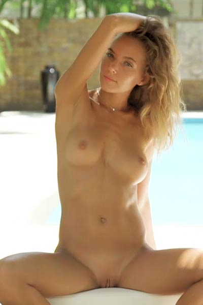 Brunette Katya Clover bares her perky firm tits while posing by the pool