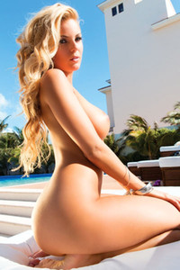 Wonderful blonde Abby Parece parts her legs and shows off her creamy pussy