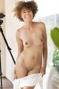Ebony with light skin and sexy perky tits slowly strips and poses for a magazine