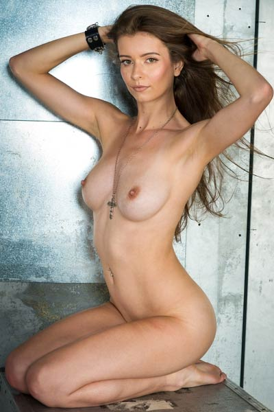Those small nipples are all stiff and erect from the sensation she is feeling while posing naked