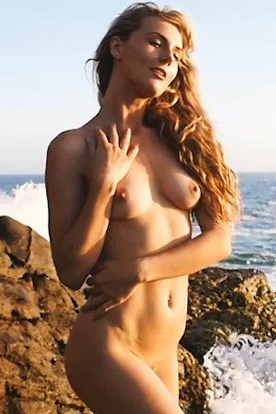 Adoring angel Jennifer Love showcases her delightfully shaped body as she poses by the sea