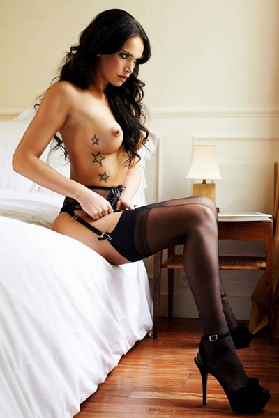 Superb Noelle Mondoloni gets naked and seductively poses naked in her bedroom