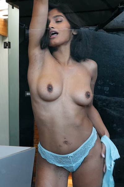 Hottie with nice boobs and trimmed pussy teasing naked in the bathroom
