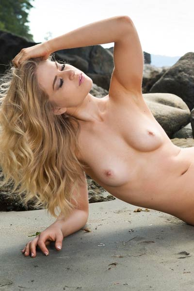 Beautiful blonde hottie takes her black bikini off on the lonely beach