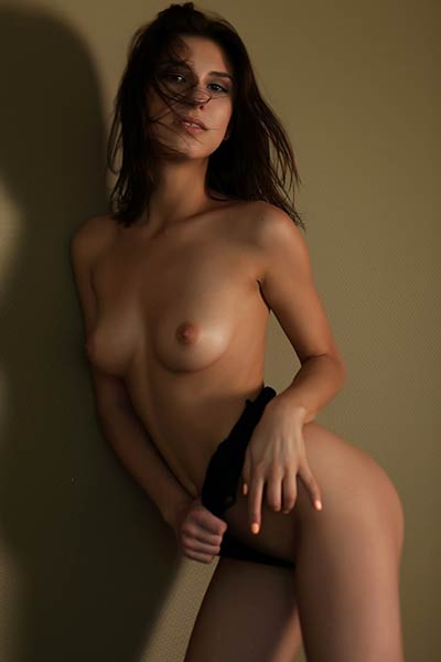Good looking young brunette wants you to feel her slender body