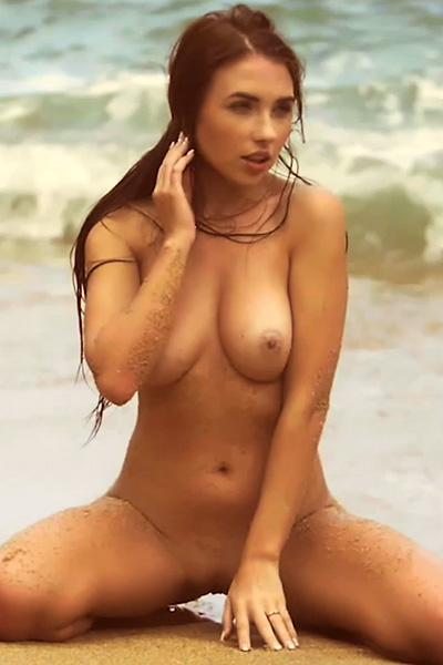 Hot and horny young girl gets her self naked on the beach
