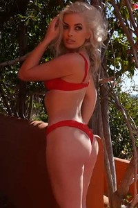 Katie Jean slips out of her sexy red lingerie and get wet outdoors in the backyard