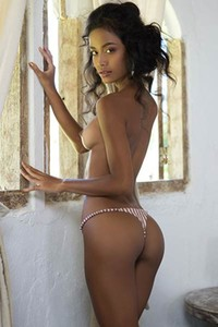 Perfect slim fit ebony lets us see her posing naked with style