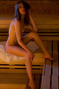 Attractive young chick with nice body goes wild in naked sauna action