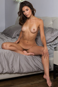Super sweet brunette with stunning slim fit body poses sensually naked in her bedroom