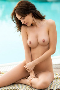 Slim and adoring teases and shows of her stunning body in front of a camera on the poolside
