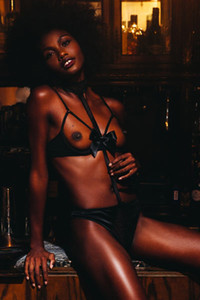 A hot ebony chick Milan Dixon bares her slender body with small tits and tight ass