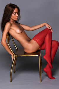 Adorable young brunette with super skinny body poses nicely giving you something to think about