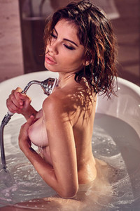 Stunning brunette lets us see her breathtaking body while she is passionately posing in bathtub