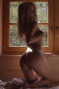 Romantic and effortlessly beautiful Zhenya Belaya takes her clothes off and shows her perfect body