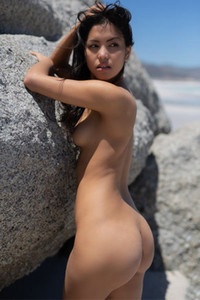 Adorable sweetheart is on the beach sensually poses showing her slim sexy body