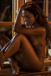 Exotic ebony Nirmala Fernandes slowly strips off her panties and shows off her butt and cunt
