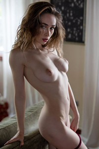 The pretty lady puts down her clothes and shares her amazing natural boobs