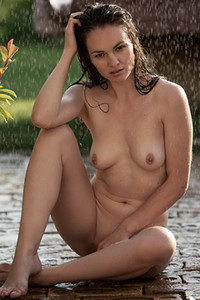 Small titted girl fully naked shares her curves in the rain