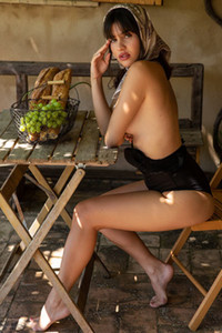 Hottie in black bodysuit bares her natural body as she poses on the chair