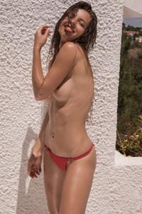 Julia Zu is poolside getting naked and doing sunbathing