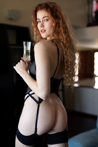 Lovely redhead in sexy black lingerie stripping and posing in the living room