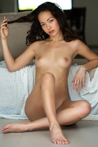 Dazzling babe shows off her petite body with small tits on the sofa